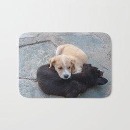 Cute white and black puppies Bath Mat