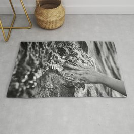 Running hand through the water, under the blue again black and white photograph / art photography Rug