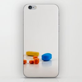 Colored medicines on a neutral background iPhone Skin