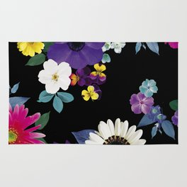 Bright flowers on a black background Rug