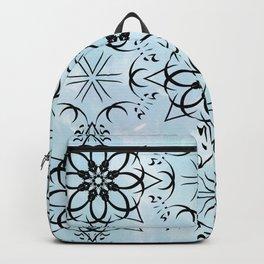 Black fishnet pattern on blue sky background. Backpack