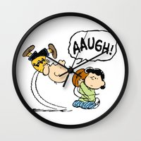 charlie brown Wall Clocks featuring Charlie Brown Foot Ball by PSimages