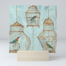 Vintage dream- Exotic colorful birds in cages on teal background Mini Art Print