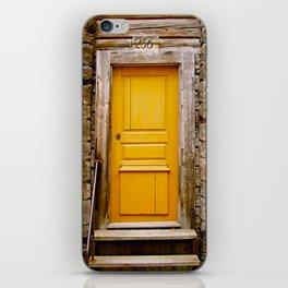 What lies behind the orange door? iPhone Skin