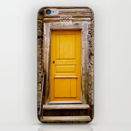 What lies behind the orange door? iPhone Skin