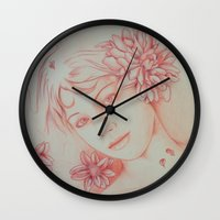leah flores Wall Clocks featuring Flores. by marmaseo