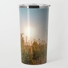 Uncultivated field in the Lomellina countryside at sunset full of yellow flowers Travel Mug