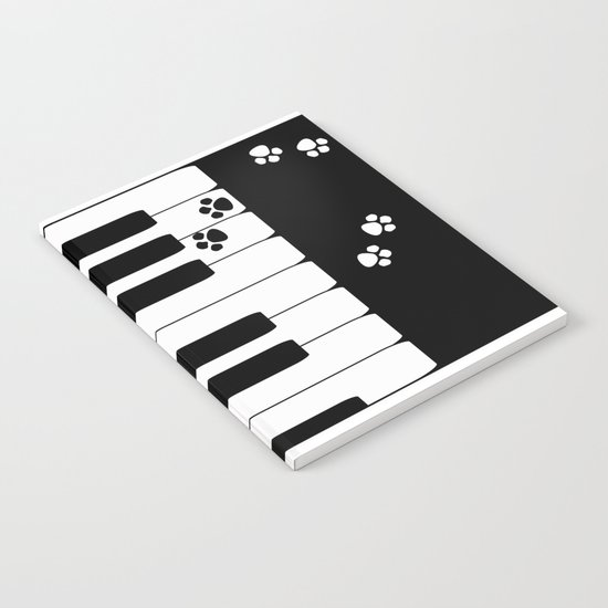 The keys of the piano . Creative black and white pattern . Notebook