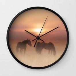 Horses in a misty dawn Wall Clock