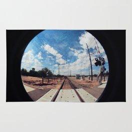 textured tracks circle Rug