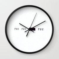 parks and rec Wall Clocks featuring rec rec _ rec by Oleg Perkowsky