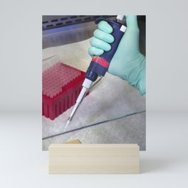 A scientist preparing samples for mass spectrometry in order to determine the presence of a bacteria Mini Art Print