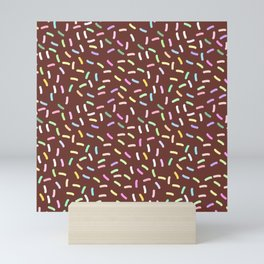 chocolate Glaze with sprinkles. Brown abstract background Mini Art Print
