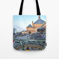 bicycles Tote Bags featuring bicycles by  Agostino Lo Coco
