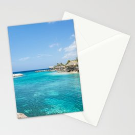 Blue water lake with huts and palm trees around Stationery Cards