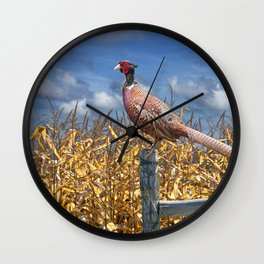 Ringneck Pheasant sitting on a fence post by a cornfield Wall Clock