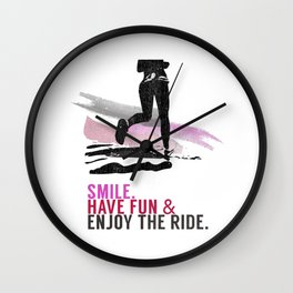Woman running with a smile Wall Clock