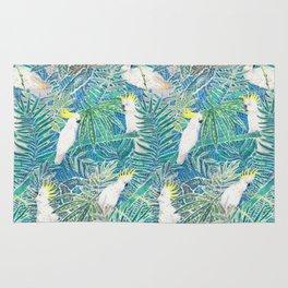 cockatoos playing around in a tropical garden watercolor Rug