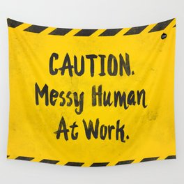 CAUTION. Messy Human At Work Wall Tapestry