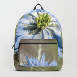 Blue flower close up Nigella love in the mist Backpack