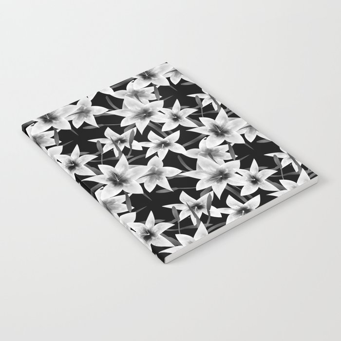 White lilies on a black background . Notebook