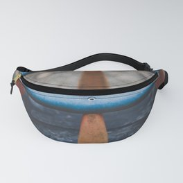 A swing at a playground Fanny Pack