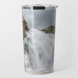 Summer landscape: mountain waterfall falling into snowfield Travel Mug