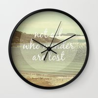 not all who wander are lost Wall Clocks featuring Not All Who Wander Are Lost by Jillian Audrey