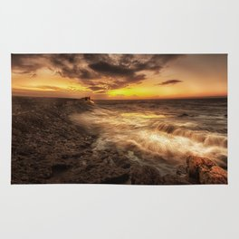 Porthcawl Sunrise with an oil painting effect on the sea Rug
