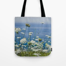 Flowers by the Beautiful Blue Sea Tote Bag