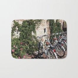 Bikes Along a Brick Wall Bath Mat