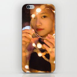Woman Through String of Lights iPhone Skin