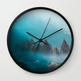 Shining light on foggy autumn forest Wall Clock