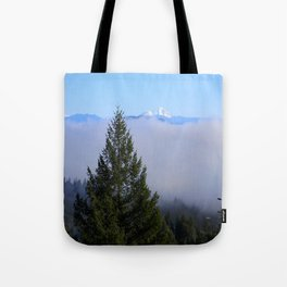 Beyond the fog is Mount Lassen.... Tote Bag