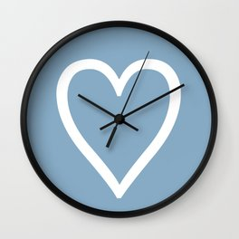 Heart sign on placid blue background Wall Clock