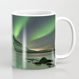 Aurora borealis over a frozen lake in northern Norway Coffee Mug