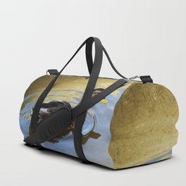 Duck swimming in a golden lake Duffle Bag