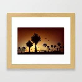 Sunsets and sunrises over the savanna with palm trees Framed Art Print