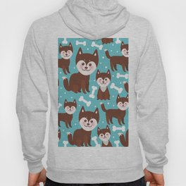 funny brown husky dog and white bones, Kawaii face with large eyes and pink cheeks blue background Hoody