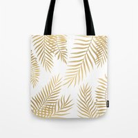 Tote Bags featuring Gold palm leaves by Marta Olga Klara