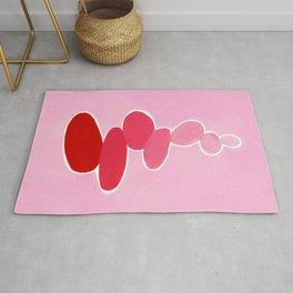 Rock balancing in pink Rug