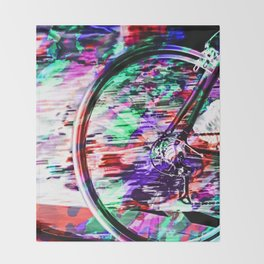 bicycle wheel with colorful abstract background in green red and purple Throw Blanket