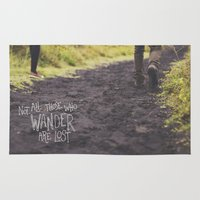 not all those who wander are lost Area & Throw Rugs featuring Not All Those Who Wander Are Lost by Tinne Cornelissen
