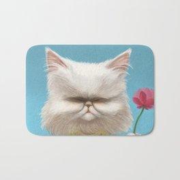 A cat holding a flower Bath Mat