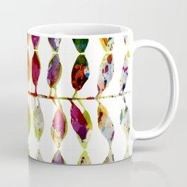 row of colored leaves Coffee Mug