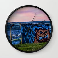 grand theft auto Wall Clocks featuring Oxygen Theft by Mark Nelson