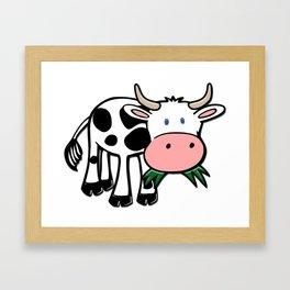 Black and White Steer Munching Grass Framed Art Print