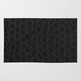Black spiraled coils Rug