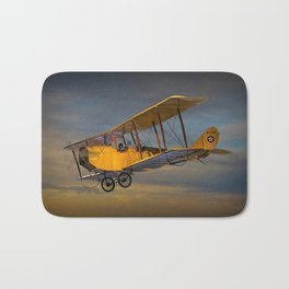 Yellow Biplane with Sunset Cloudy Sky Bath Mat