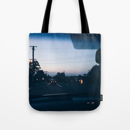 Driving into the sunset Tote Bag
